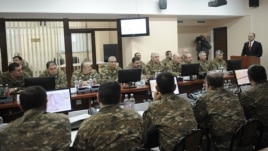 Armenia - Defense Minister Seyran Ohanian (R) addresses the army top brass in Yerevan, 13Feb2012.