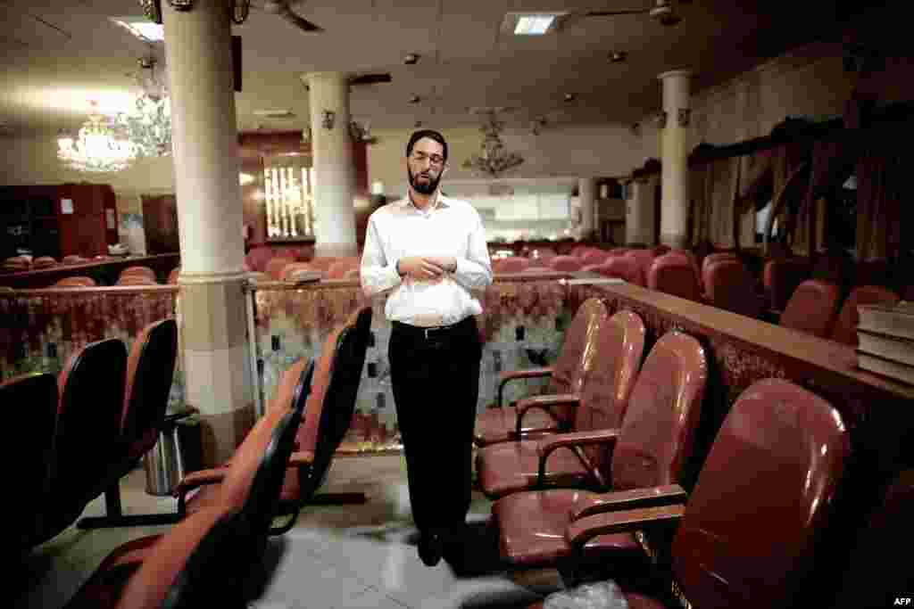 An Iranian Jew performs prayers at a Tehran synagogue.
