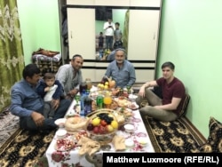 Reporter Matthew Luxmoore (right) with Abdukholik Gadoev, his friends Azam and Ismail, and one of his many grandchildren.