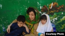 Iranian human rights activist, Narges Mohammadi with her children, Ali (left) and Kiana (right) file photo