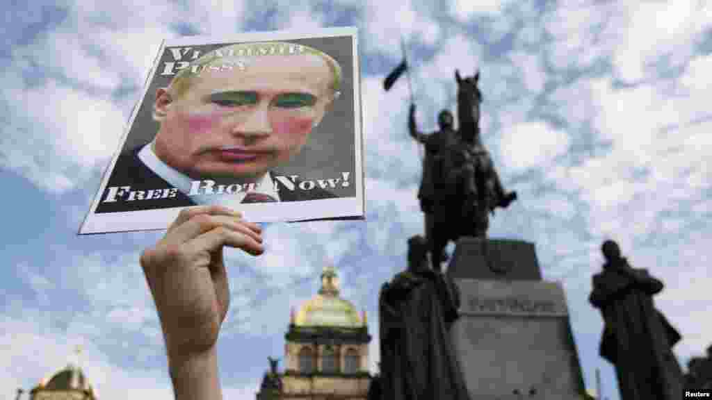 An activist holds up a poster depicting Russian President Vladimir Putin during a protest rally in support of Pussy Riot on Wenceslas Square in Prague. (Reuters/David W. Cerny)