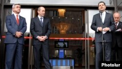 Armenia - Outgoing President Robert Kocharian, President-elect Serzh Sarkisian and Central Bank Chairman Tigran Sarkisian attend the inauguration of a commercial bank headquarters in Yerevan, 4Apr2008.