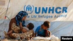 Сирийские беженцы в палаточном лагере, расположенном недалеко от города Эрбиль в иракской провинции Курдистан. 20 августа 2013 года.