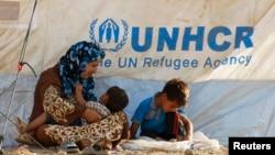 Сирийские беженцы в палаточном лагере, расположенном недалеко от города Ирбил в иракской провинции Курдистан. 20 августа 2013 года.