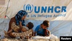 Босқындарға арналған баспаналарда тұрып жатқан сириялықтар. Ирак.