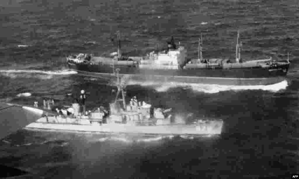 A U.S. destroyer stops a Soviet cargo in order to check the freight on November 12, weeks after Krushchev announced the missile removals over Radio Moscow.