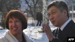 Kyrgyz Foreign Minister Erlan Abdyldaev (right) meets with EU foreign-policy chief Catherine Ashton in Bishkek on November 27.