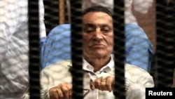 Egypt -- Ousted President Hosni Mubarak sits inside a dock at the police academy on the outskirts of Cairo, April 15, 2013