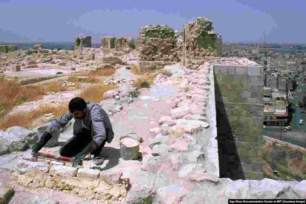 "Restoration works being carried out on the Citadel in 2004. Much of Aleppo's old town was built under the rule of the Umayyads, a Sunni Muslim dynasty that ruled over the Middle East during what many Sunnis considered a ""golden age"" until the eighth century."