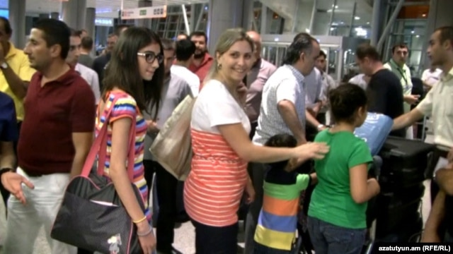 Armenia - A newly arrived Syrian Armenian family at Yerevan's Zvartnots airport, 30Jul2012.
