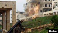 Syria -- A locally made shell is launched by rebel fighters towards government forces at the frontline in al-Breij district of Aleppo, December 10, 2014