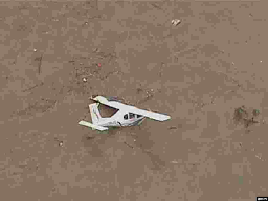 Australia -- A plane is seen in floodwaters in Grantham, a township between Toowoomba and Brisbane, 10Jan2011