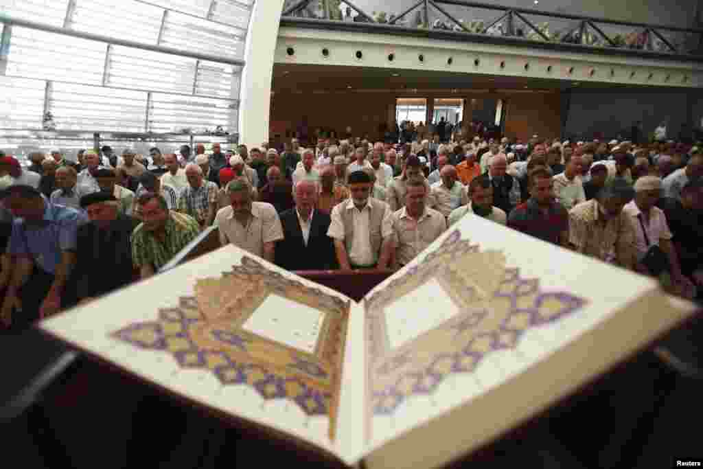 Worshippers pray in the newly opened mosque.