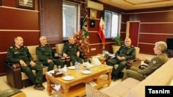 Iranian Defense Minister Amir Hatami (R), in a meeting with IRGC commanders including Khamenei advisor Yahya Rahim Safavi (C) in Tehran, on August 28, 2017.