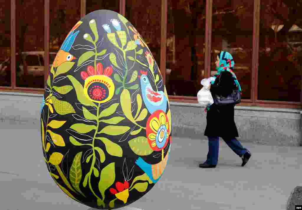 An Iranian woman walks past a large decorated egg, a symbol of Nowruz, the Persian New Year, in Tehran. The Persian New Year, starting on March 20, also marks the beginning of spring. The holiday has been celebrated for at least 3,000 years and is the most revered in the greater Persian world, which includes the countries of Iran, Afghanistan, Azerbaijan, Turkey, portions of western China, and northern Iraq. (epa/Abedin Taherkenareh)