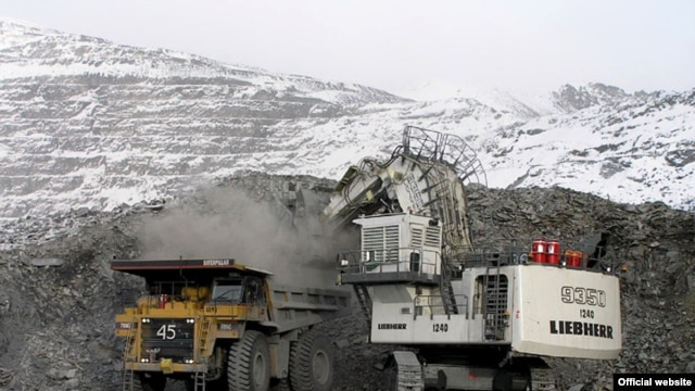 Trucks load ore at the Kumtor gold mine