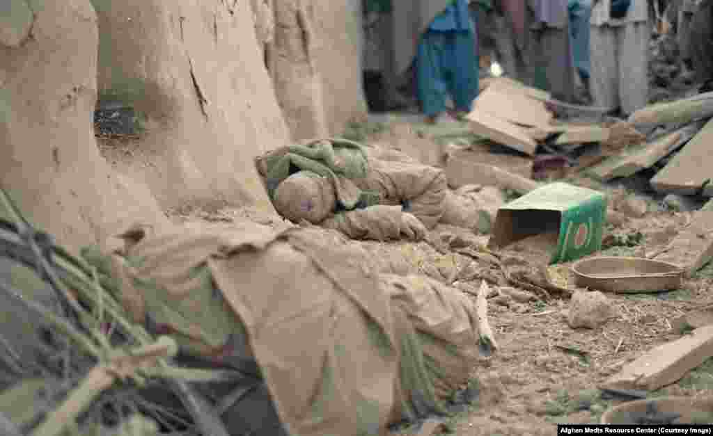 The body of an Afghan man killed in a Soviet bombardment. At least 500,000 Afghan civilians were killed and 5 million more -- or one-third of the population -- displaced.
