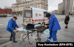 Paramedics take an elderly woman to the hospital durinig the coronavirus lockdown in central Moscow.