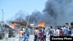 ألسنة اللهب والدخان تلتهم سوق هرج في الناصرية