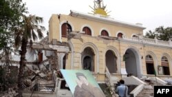 A portrait of Muammar Qaddafi is placed outside the destroyed premises of the General People's Congress after it was targeted by a NATO air strike in Tripoli on June 6.