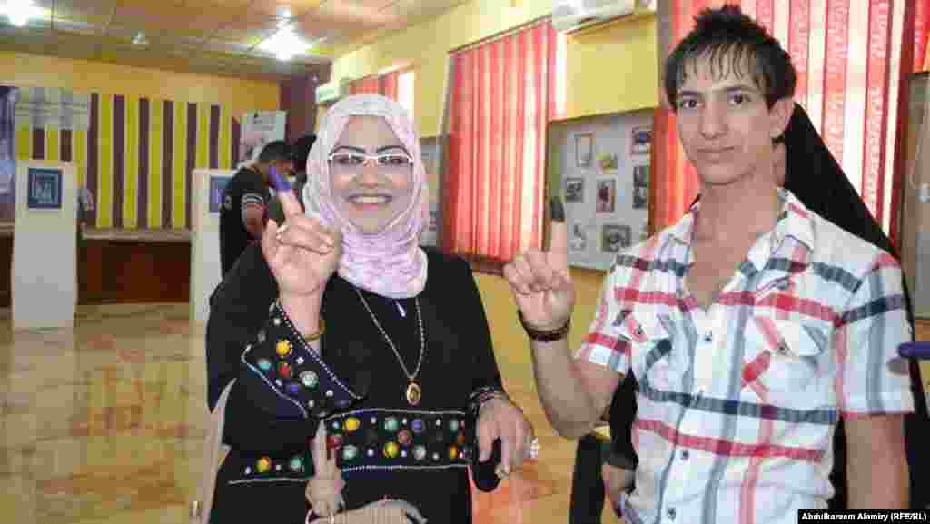 Voters after casting their ballots in Basra.