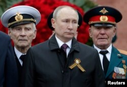 Vladimir Putin takes part in a Victory Day commemoration ceremony in Moscow on May 9.