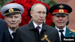 Russian President Vladimir Putin takes part in a commemoration ceremony in Moscow on May 9.