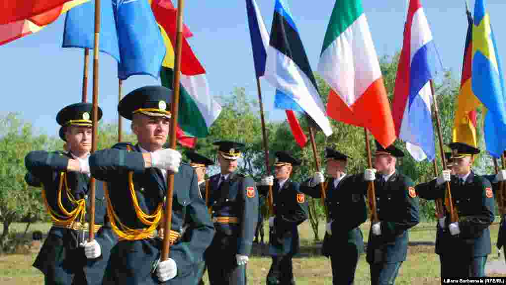 A guard of honor with NATO flags marks the start of the initiative.