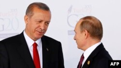 Turkish President Recep Tayyip Erdogan (left) greets Russian President Vladimir Putin prior to the G20 summit in Antalya in November 2015.