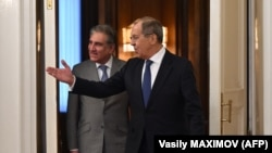 Russian Foreign Minister Sergei Lavrov (right) welcomes Pakistani Foreign Minister Shah Mehmood Qureshi during his visit to Moscow on December 26.