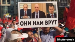 """They Are Lying To Us"": A protest against pension reform in Moscow with a placard featuring Russian President Vladimir Putin (left), Anton Siluanov, the first deputy prime minister, and Prime Minister Dmitry Medvedev."
