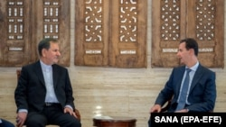 Syrian President Bashar Assad (R) meets with Iranian First Vice-President Eshaq Jahangiri in Damascus, January 29, 2019