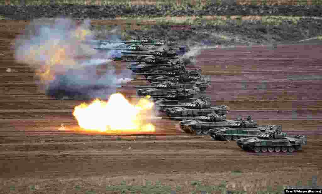 T-72B tanks fire during military exercises at a training ground in Kazakhstan's Almaty Region. (Reuters/Pavel Mikheyev)