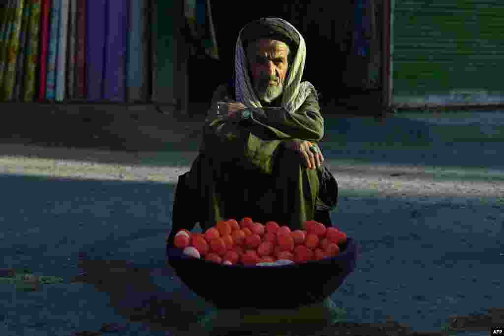 An Afghan street vendor sells eggs by the roadside in Kabul. (AFP/Wakil Kohsar)