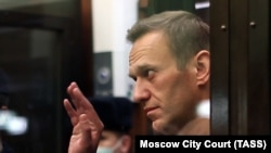 RUSSIA -- Russian opposition activist Aleksei Navalny gestures during a court hearing in Moscow, February 2, 2021