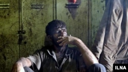 Iran - A Miner is smoking after his working shift.