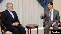 علاء الدین بروجردی (چپ) میگوید که «حمایت اقتصادی و سیاسی» ایران از دولت آقای اسد تا «پیروزی کامل بر تروریسم» ادامه مییابد.