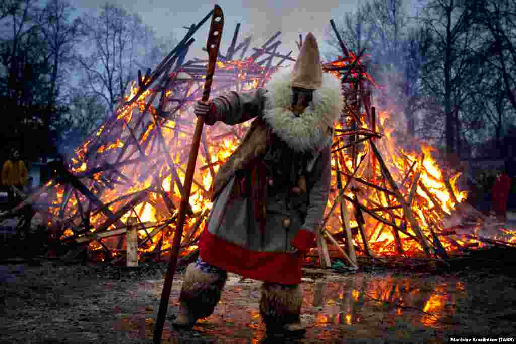 Burning an effigy of winter during a celebration of Maslenitsa festival at the Guslitsa Art Estate, Moscow region, March 1, 2020. The holiday celebrates the end of winter and marks the arrival of spring. It dates back to the pagan times.