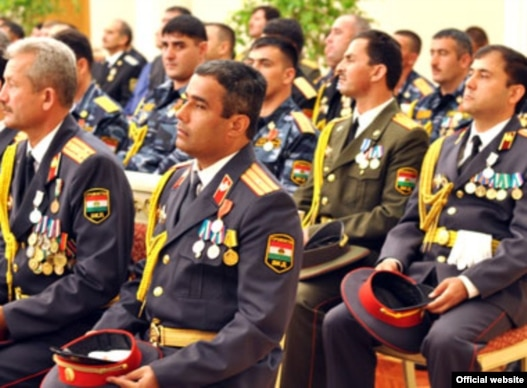A group of Tajik officers attend a ceremony to receive promotions from President Emomali Rahmon.