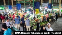 File photo - People buy vegetables and fruits at the Tajrish Bazaar in northern part of Tehran, Iran, August 2, 2017, before US sanctions led to hyper-inflation.