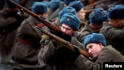 Participants dressed in historical uniforms perform during a military parade marking the anniversary of the 1941 parade when Soviet soldiers marched toward the front lines of World War II, in Red Square in Moscow on November 7.