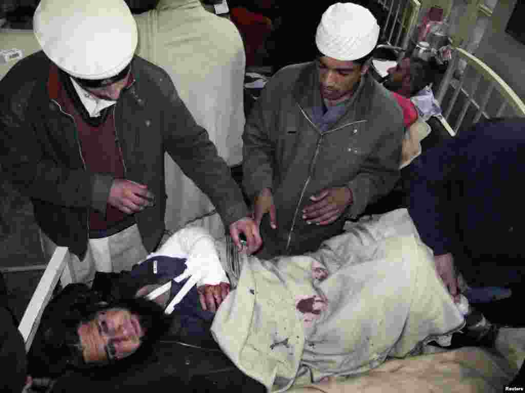 A wounded man receives treatment in Mingora.