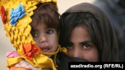 Two children at a UN camp. Photo by RFE/RL's Radio Free Afghanistan - NATO's leading civilian representative, Mark Sedwill, caused an uproar recently when he said children are safer in Kabul than they are the Scottish city of Glasgow. Click here to view photos of children living in the Afghan capital and see if you agree.
