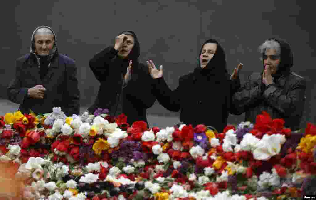 People mourn at the Tsitsernakaberd Armenian Genocide Memorial Museum in Yerevan on April 21. (Reuters/David Mdzinashvili)