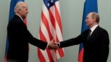 Then-Russian Prime Minister Vladimir Putin (right) shakes hands with then-U.S. Vice President Joe Biden during a meeting in Moscow in 2011.