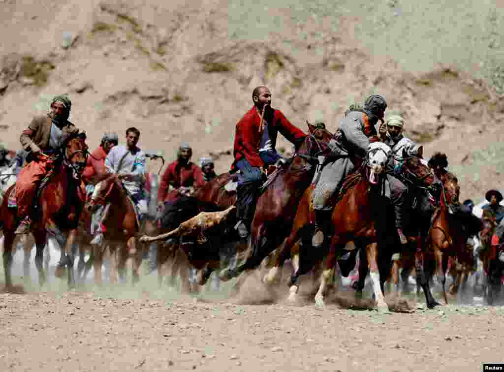 Afghan horsemen compete during a buzkashi game in Panjshir Province, north of Kabul. (Reuters/Omar Sobhani)