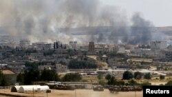 دخان معارك يتصاعد من كوباني السورية