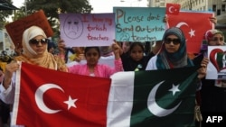 Pakistani students of the private PakTurk International Schools and Colleges hold placards during a protest in Karachi on November 18.