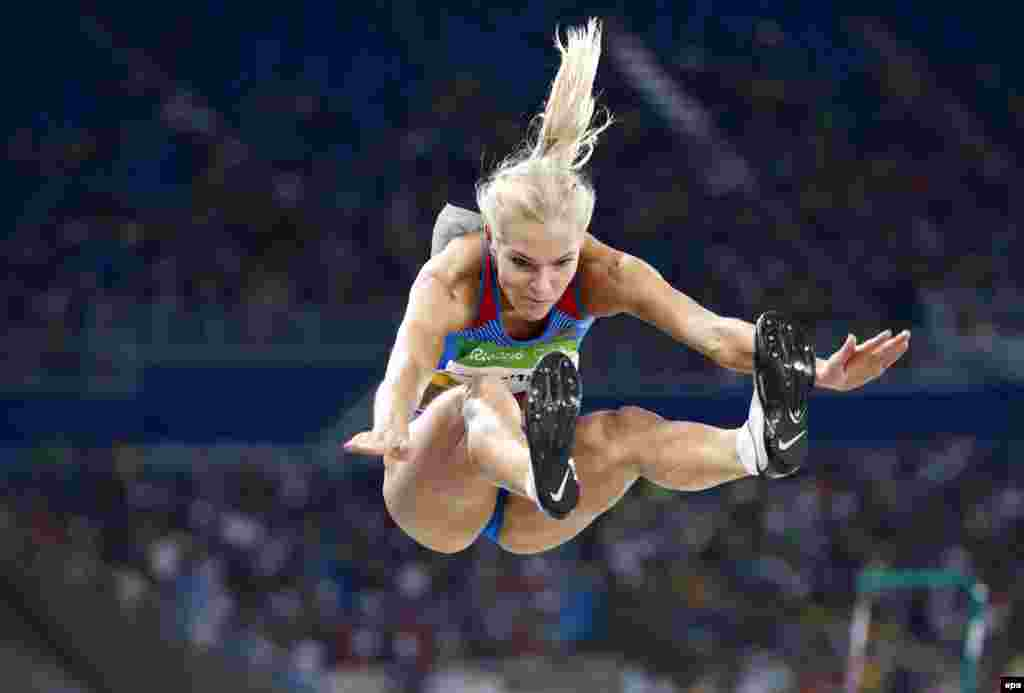 Darya Klishina of Russia competes in the women's long-jump qualifying round.