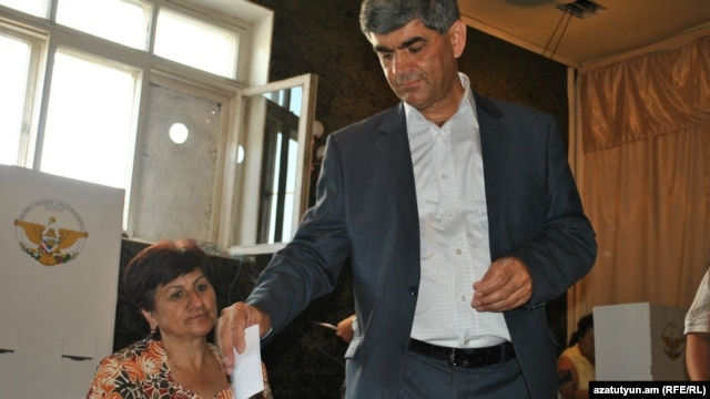 Nagorno Karabakh - Vitali Balasanian, the main opposition candidate, casts his vote in a presidential election, Askeran,19Jul2012